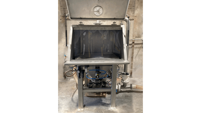 TBMA bag dumping cabinet window with plastic strips limits dust production