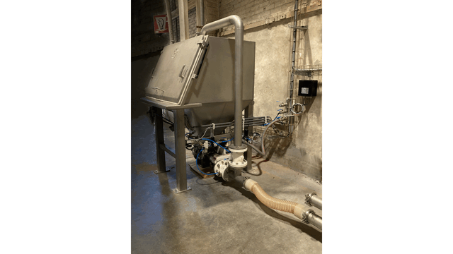 TBMA bag dumping cabinet with HGR150 blow through rotary valve