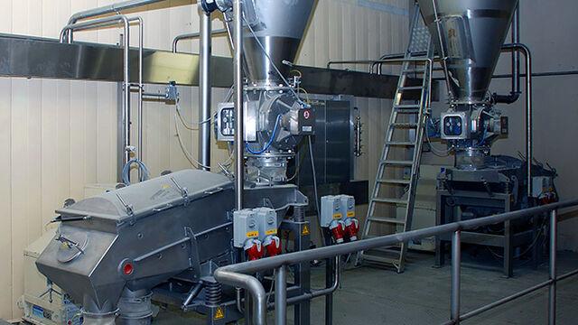 TBMA Glanbia pneumatisch transport lactose wei proteine doseersluis